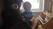 boy_reading_with_bear.jpg